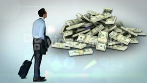 Businessman looking at money pile