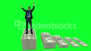 Businessman cheering on money pile