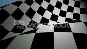 Checkered flag waving against blue sky