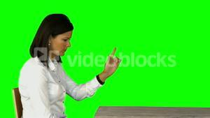 Irritated businesswoman sitting on chair on green screen