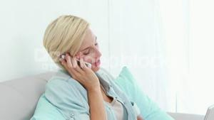 Pretty blond woman speaking at the phone