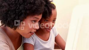 Child with her mother in the computer