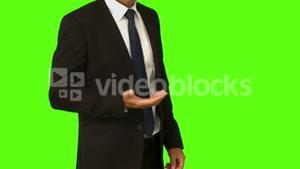 Businessman standing with hand out