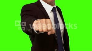 Businessman standing with fist out