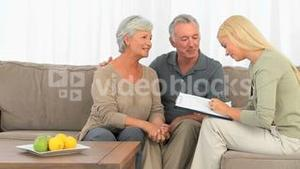 Mature couple responding to few questions