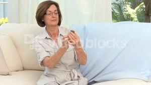 Retired woman reading the instructions of his medicine