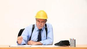 Elderly businessman working on a building project