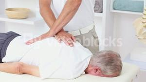 Doctor massaging his patients back