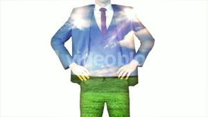 Businessman with sky and grass overlay