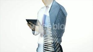 Businessman using tablet with cityscape overlay