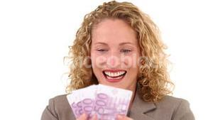 Blond woman showing us her money