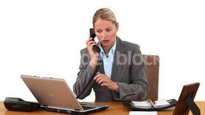 Blond businesswoman making a phone call
