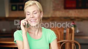 Happy pretty blonde having a phone call
