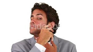 Businessman shaving