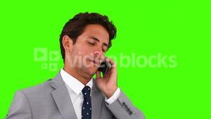 Young businessman in suit having a phone call