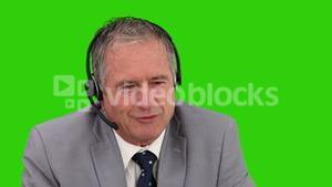 Senior businessman speaking over the headset