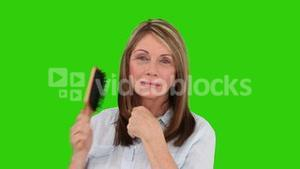 Retired woman is fixing her hair