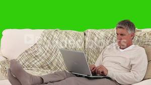 Retired man working on his laptop