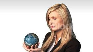 Business woman holding the world