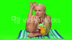 Blond woman in swimsuit lying on the beach