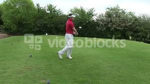 A man Teeing off in Golf