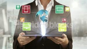 A woman presenting some electronic devices