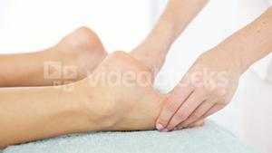 Physiotherapist doing a foot massage