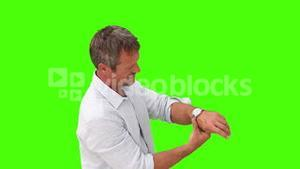 Casual man wearing a shirt putting on his watch