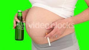Pregnant woman holding a beer and a cigarette