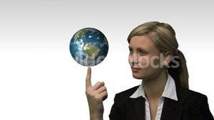 Businesswoman with the earth spinning in her hands