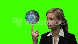 Businesswoman with the earth rotating in her hands