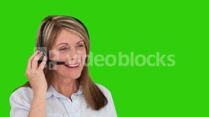 Senior woman with an headset talking