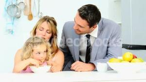 Businessman taking the breakfast with his family