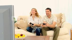 Pretty couple playing a video game