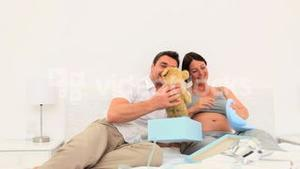 Pretty couple opening gifts