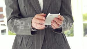 Close up of businesswoman using smartphone