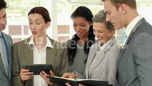 Business people with tablet and notebook