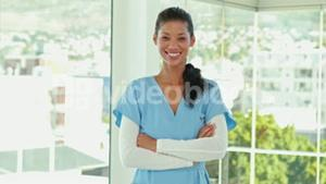 Smiling doctor with arms crossed looking at camera