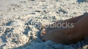 Close up view of woman foot on sand