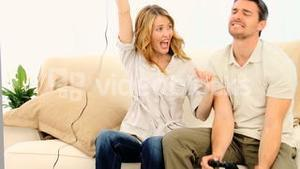 Young couple playing a video game