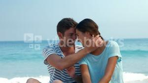 Pretty couple looking at each other at the beach