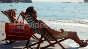 Cute couple relaxing on beach chair