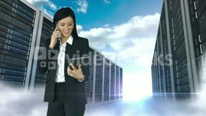 Businesswoman having phone call and holding tablet computer in server tower store