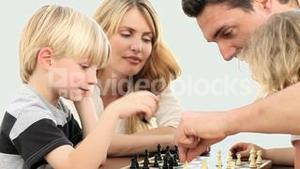 Family playing chess game