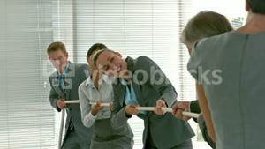 Two Business team people pulling rope