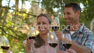 Happy couple toasting with their family
