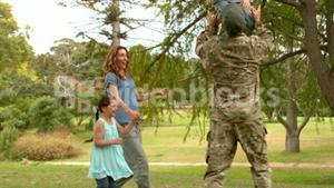 Happy soldier reunited with his family