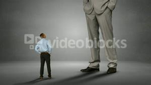 Businessman looking at giant boss