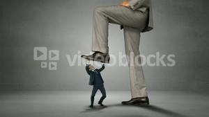 Giant boss trying to squash businessman