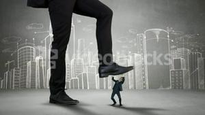 Giant boss trying to squash businesswoman